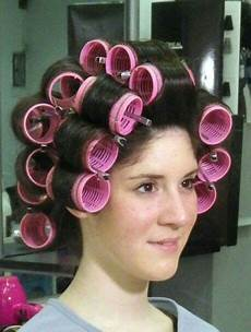 mom puts curlers in boys hair pin on 4x4 power