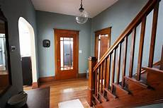 dulcious stratton blue in the front hall wood trim