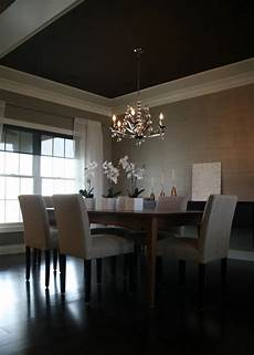 chic dining room design with gray grasscloth wallpaper white sheers walnut dining table gray