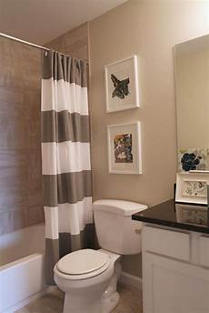 i like the linen tiles in the bath surround goes well with paint color and white tub