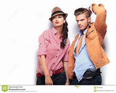male and female model man and woman fashion models looking away stock photo
