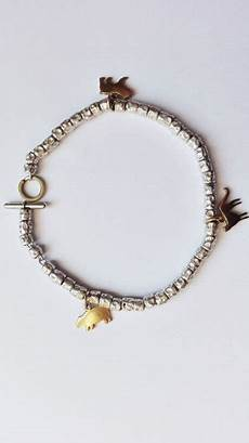 pomellato pepite dodo by pomellato bracelet with 3 charms in 750 gold