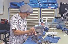 sterilization technician ensures tools are ready for surgery