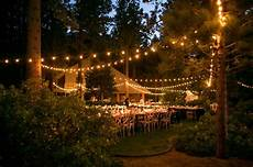 tuscan inspired wedding dinner tables under the bistro lights planning and design by one fine