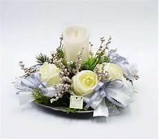 composizioni candele e fiori centro tavola tondo bianco con candela a led creazioni