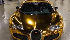and luxury car rentals at diamond rentals flo rida wraps his bugatti in gold
