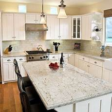 river white granite countertops brushed nickle hardware and lighting fixtures white granite