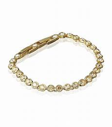 swarovski armband gold swarovski golden shadow tennis bracelet in gold lyst