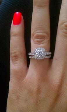 classic diamond in a cushion halo engagement ring with pave diamond wedding band in