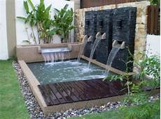 Desain Kolam Ikan Didepan Rumah Paduan Alami Taman Cantik