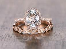 oval cut aquamarine diamond pave halo engagement ring matching art deco wedding band