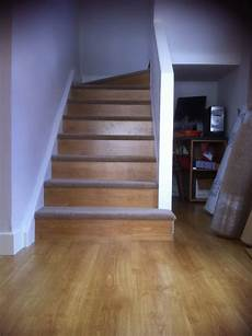 our diy staircase using leftover laminate flooring on the