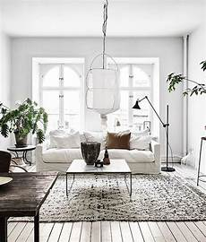 white and vintage scandinavian apartment living room