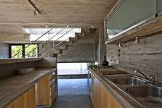 4 homes using concrete as a stylish modern house ushers in industrial style with concrete
