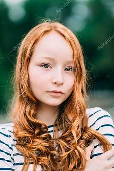 young girl with red hair stock photo image of forest an adorable smiling young woman with green eyes and long curly red hair in summer park outdoor