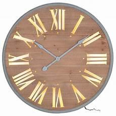 light up wall clocks uk brown wooden light wall clock interior flair