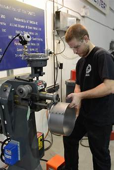 apprentices using empire s emt 7r power rotary machine in bc s sheet metal worker s training