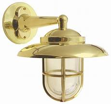 hooded wall light with cage solid brass interior exterior by shiplights style
