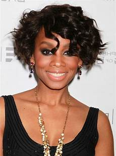 african american short curly bob hairstyle with bangs