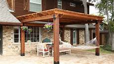 outdoor living pergola built using bases rafter and to beam from the