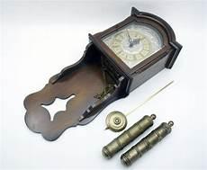 pendeluhr wanduhr pendel und gewichte aus bronze tempus