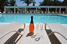 lounge chairs at the hotel pool picture of corfu palma boutique hotel dassia tripadvisor