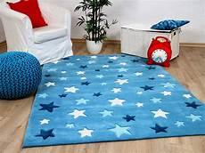 Sternen Teppich Kinderzimmer - kinderteppich sterne blau haus deko ideen