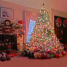 sparkling christmas tree backdrop printed garlands gift boxes indoor fireplace merry