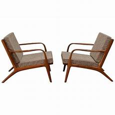 mid century walnut lounge chairs by adrian pearsall with