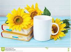 fiori coffee white coffee cup with sunflowers and yellow books on blue