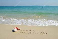 merry christmas written tropical white sand with s 169 firefox 40386295