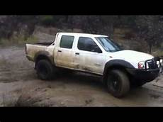 lifted nissan navara d22 burnouts in the mud