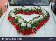 white bouquet on white bridal car wedding car