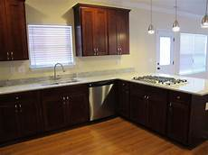 moon white granite mahogany cabinets light floor love