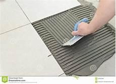 fliesen verlegen anleitung laying ceramic tiles stock photo image of concrete