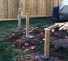 Support Posts Installed On Top Of Sonotubes For A New Deck
