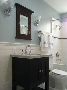 i like the contrast of the dark wood bright shiny tiles and the light blue wall color