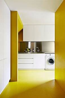 10 reasons why you should paint your laundry room yellow domino yellow laundry rooms yellow