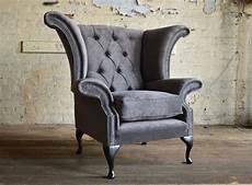 clifton velvet chesterfield wing chair abode sofas