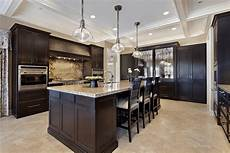 kitchen floor ideas with dark cabinets choices of kitchen floors with white vs dark cabinets