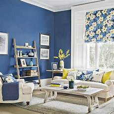 modern blue living room with forsythia yellow accents ideal home