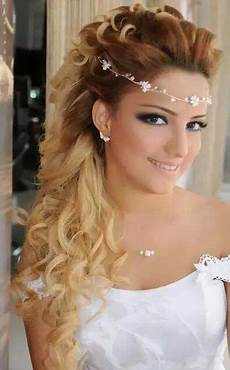 prom hair with forehead band bridesmaid hair down curly