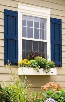 tan house blue shutters lexington in 2019 outdoor shutters exterior house colors house
