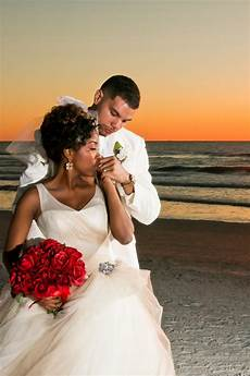 a glamorous red and white beach wedding in florida munaluchi bride