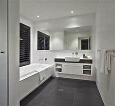 white bathroom with charcoal floor tiles and caesarstone