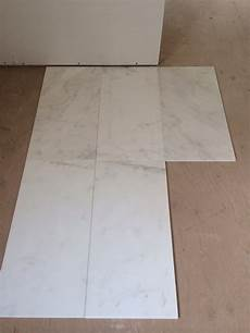 master ensuite tile carrara marble or calcutta porcelain