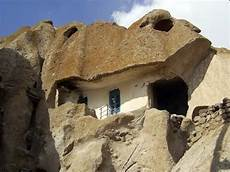 an innovative house carved out of a amazing 700 years houses in iran and
