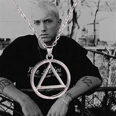 eminem illuminati necklace why does eminem wear that necklace with the illuminati