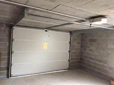 pose d une porte de garage sectionnelle motoris 233 e 224