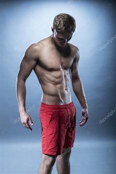 fitness models with male fitness model wearing red shorts stock photo